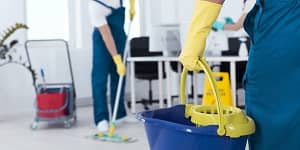 our end of lease cleaning team, one has mob another person has cleaning bucket