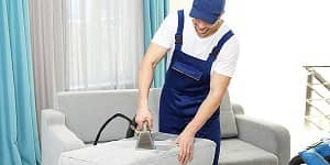 the sofa cleaning operator steam clean the couch by using steam wand